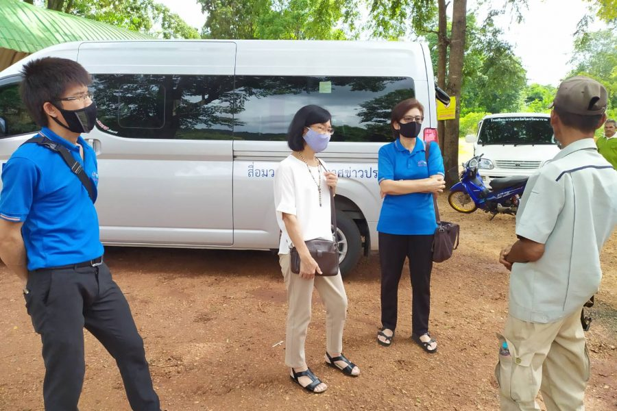 Visiting and distributing radios to village in Thailand.
